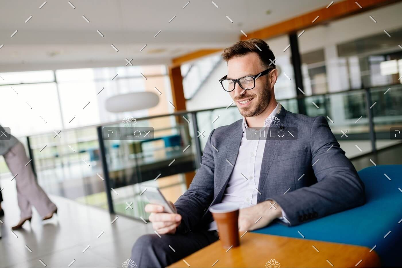 demo-attachment-502-businessman-taking-a-break-with-a-cup-of-coffee-JW4B3DH